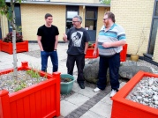 Dan, Paul and Barry after painting the planters